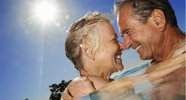 older couple swimming together